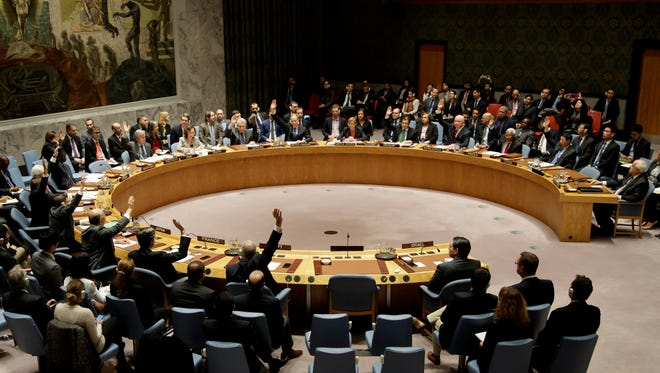 The United Nations Security Council votes to pass a resolution condemning Israeli settlement construction at United Nations headquarters in New York on Dec. 23, 2016.