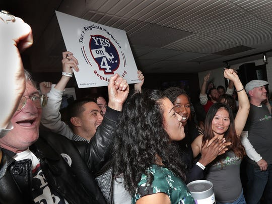 Supporters celebrate during the vote yes on Question Four to legalize marijuana party at Lir restaurant in Boston, Mass. Nov. 8, 2016.