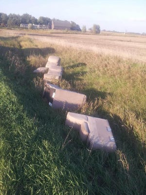 Furniture in the ditch along 468th Avenue, just north of Tea.