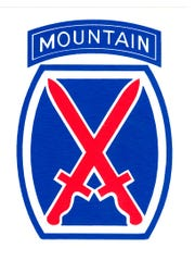 """U.S. Army shoulder patch worn by the 10th Mountain Division. The crossed red swords form the Roman numeral for """"10."""" The background is a blue powder keg. The """"Mountain"""" rocker was separate from the main patch and signified the division was considered to be elite."""