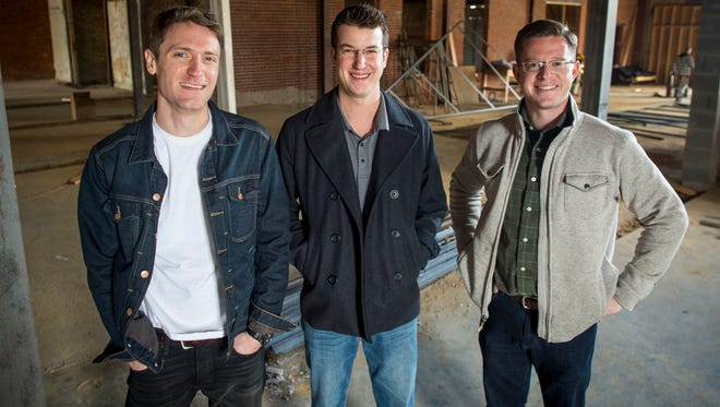 From left, executive chef Ryan Davenport, brewmaster Alex Violette and building co-owner and invested Joe Fox inside the future Elkmont Exchange Brewery and Eating House, which will occupy a 10,000-square-foot building that formerly was home to Rentals Rentals at 745 N. Broadway.