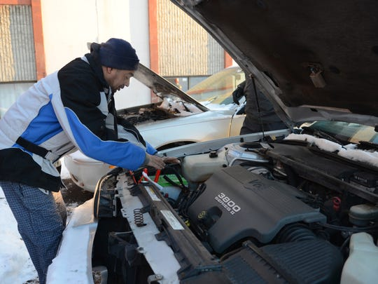 Angel Rosa needed to jump-start his car as subzero temperatures hit the Green Bay area on Monday morning.