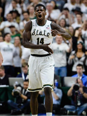 Spartans Eron Harris (14) screams out after hitting a three-pointer during the first half of the Spartans game with Wisconsin Thursday, Feb. 18, 2016 at the Breslin Center in East Lansing.