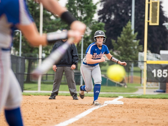Spring Grove's Julia Wivell takes a lead off third
