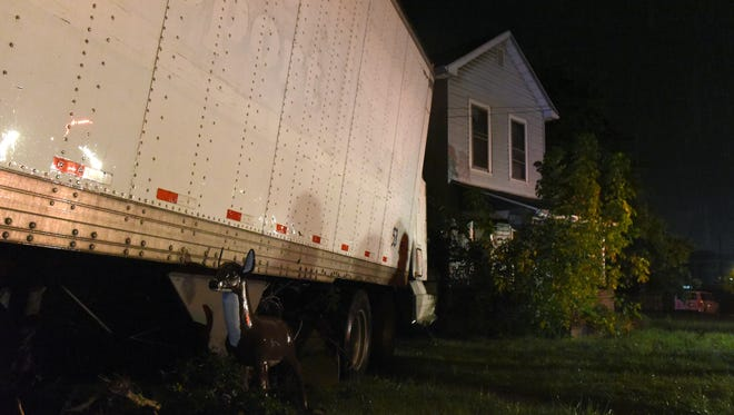 An unattended semi truck collided with a pair of houses on South State Street on Wednesday night, according to the Zanesville Police Department. No major injuries were reported.