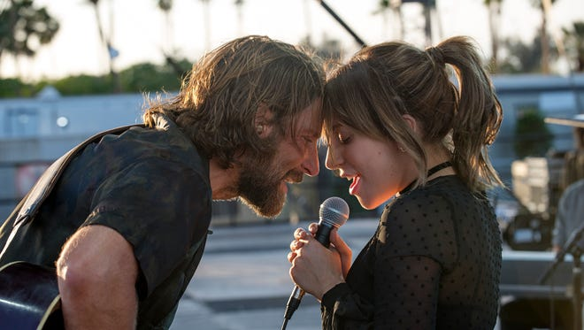 """In """"A Star Is Born,"""" Jackson (Bradley Cooper) takes Ally (Lady Gaga) on the road."""