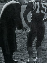 (POCEAN) Brick, NJ 6/14/07 Brick Township High School yearbook photo of Coach Warren Wolf coaching a player during the 1958-1959 school year. copy photo by Tanya Breen