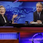 "FILE - In this July 15, 2014 file photo, former U.S. Secretary of State Hillary Rodham Clinton reacts to host Jon Stewart during a taping of ""The Daily Show with Jon Stewart,"" in New York. Stewart enters the home stretch of his 16 years on Comedy Central's ""The Daily Show"" on Monday, with 12 more nights of jokes at the expense of those who make and report the news before he signs off for good on Aug. 6."