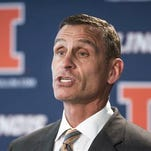 FILE - In this Aug. 28, 2015, file photo, University of Illinois athletic director Mike Thomas announces offensive coordinator Bill Cubit as the interim coach of the Illinois football team, during a news conference in Champaign, Ill. Illinois fired athletic director Mike Thomas Monday, Nov. 9, 2015, as it prepares to release the final report from its investigation into mistreatment of football and women's basketball players. The report found no wrongdoing by Thomas, according to interim Chancellor Barbara Wilson, who praised Thomas for dealing with the string of allegations that have erupted since May. But she said the change was needed to put the past few difficult months behind the university. (Robin Scholz/The News-Gazette via AP, File ) MANDATORY CREDIT