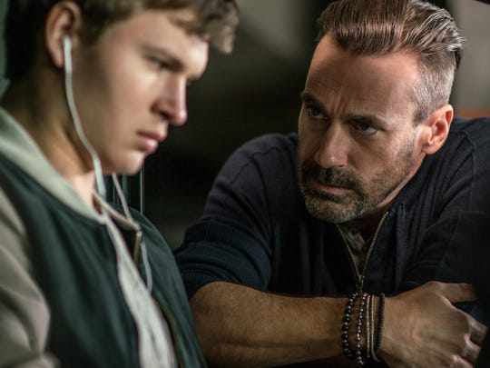 Buddy (Jon Hamm, right) confronts getaway driver Baby