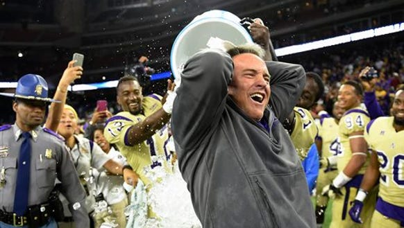Alcorn State head coach Jay Hopson is doused with liquid