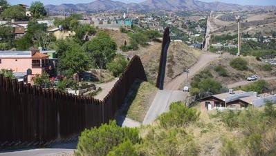 The border fence separates Nogales, Sonora (left) with Nogales, Ariz. April 21, 2014.