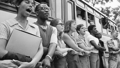 Student civil rights activists join hands and sing as they prepare to leave Ohio to register black voters in Mississippi.