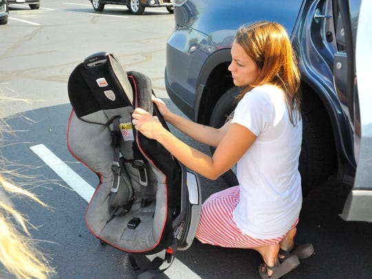 Wood County Health Department nurse Erica Sherman checks the numbers on a car seat to ensure it's not on a recall list.