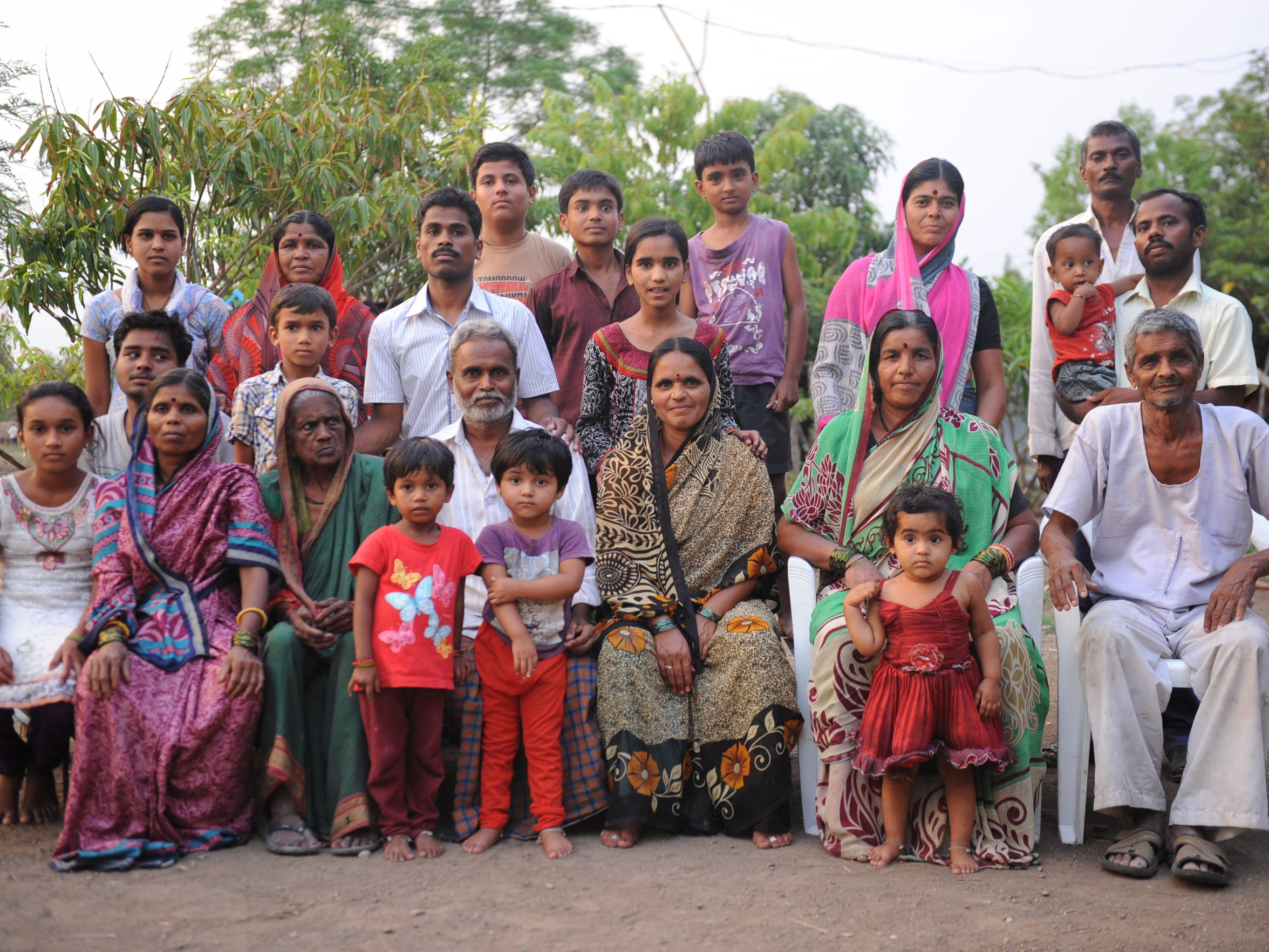Four generations of the Suryawanshi family pose for a portrait at their farm in Nagarsoga, India, in June.