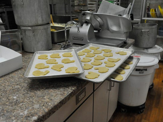 Cookie turkeys sit waiting for their turn in the oven at Opportunity Development Center's Hidden Creek Kitchen Tuesday, Nov. 24, 2015.