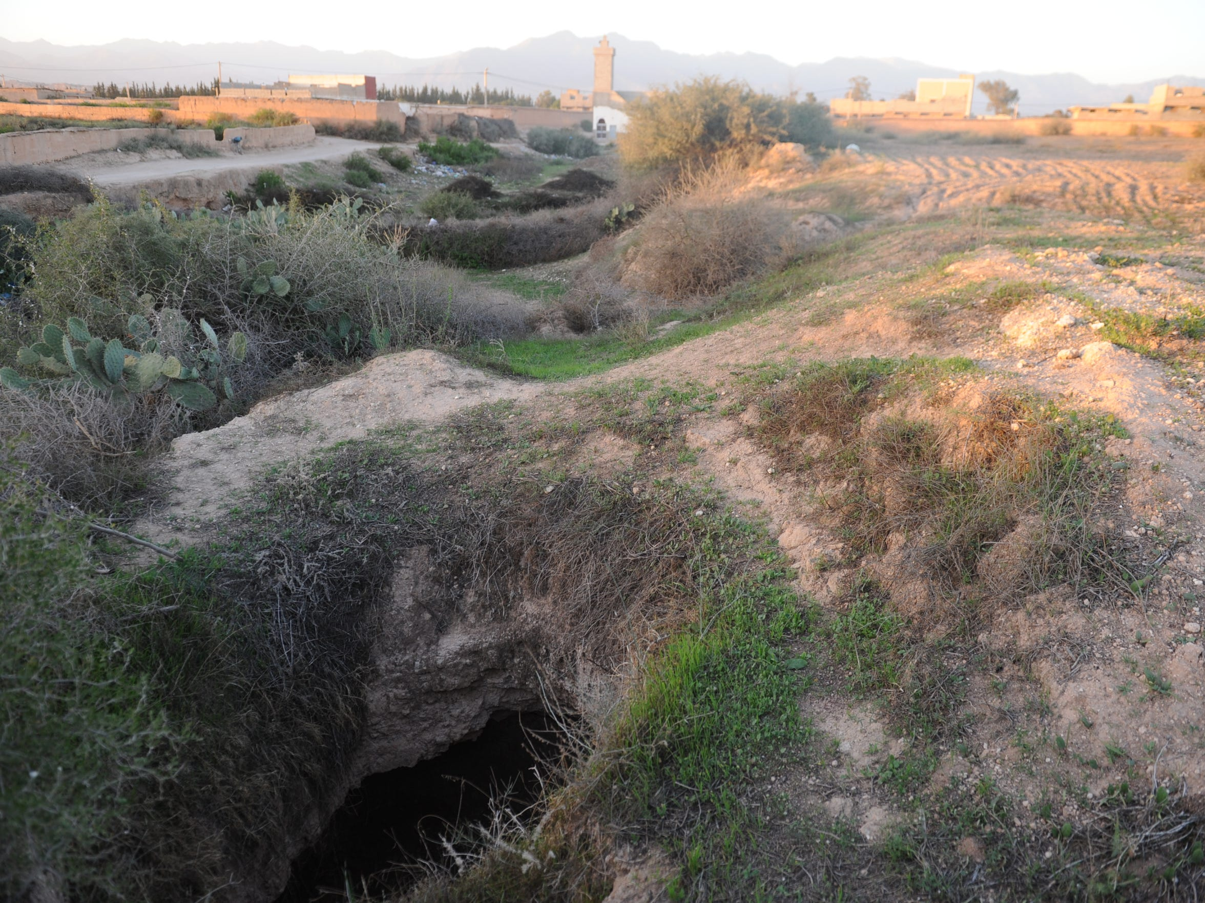 Moroccans once used underground irrigation tunnels called khettaras to capture and guide flows of groundwater to their fields. The khettaras have gone dry in many areas as groundwater levels have fallen. This hole in the ground is part of a system of khettaras in a village near Oulad Berhil that hasn''t flowed in years.