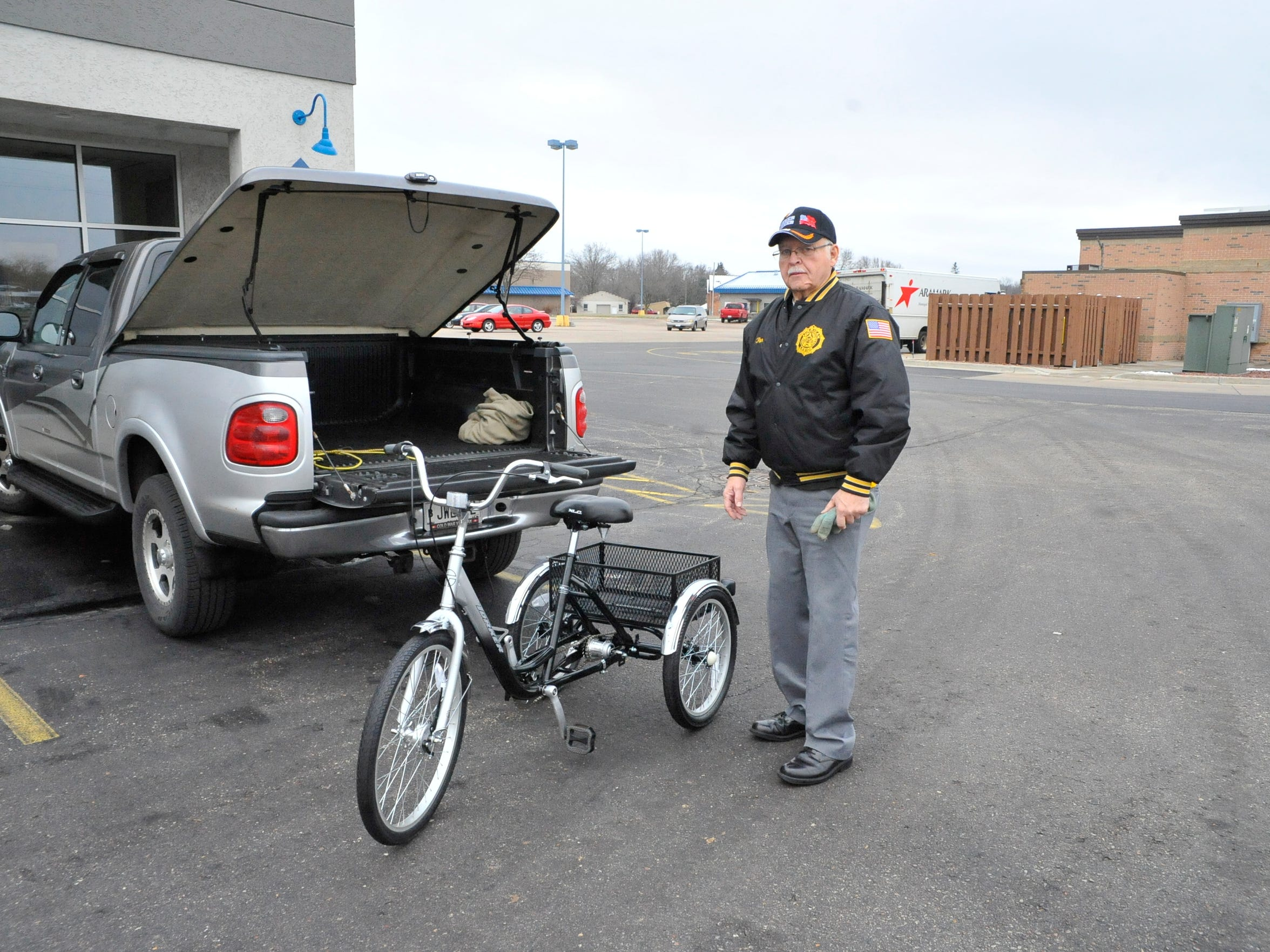 Wood County American Legion Commander Ron Miller shows off one of eight tricycles he will deliver to the State Veterans Home at King. Miller had hoped to donate six tricycles, but people in central Wisconsin stepped up and paid for eight.