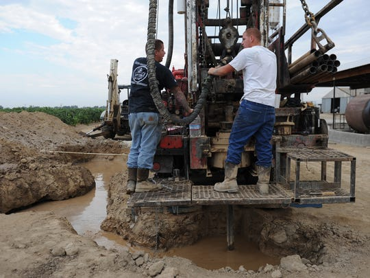 Workers drill an agricultural well in Tulare County in 2015. Well drillers have been busy replacing wells that have gone dry in the San Joaquin Valley.