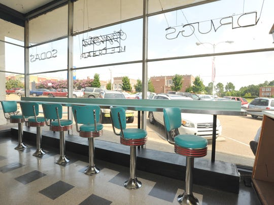 Turquoise barstools - now at the bar and in the front window - are an iconic piece at Brent's Drugs in Fondren.