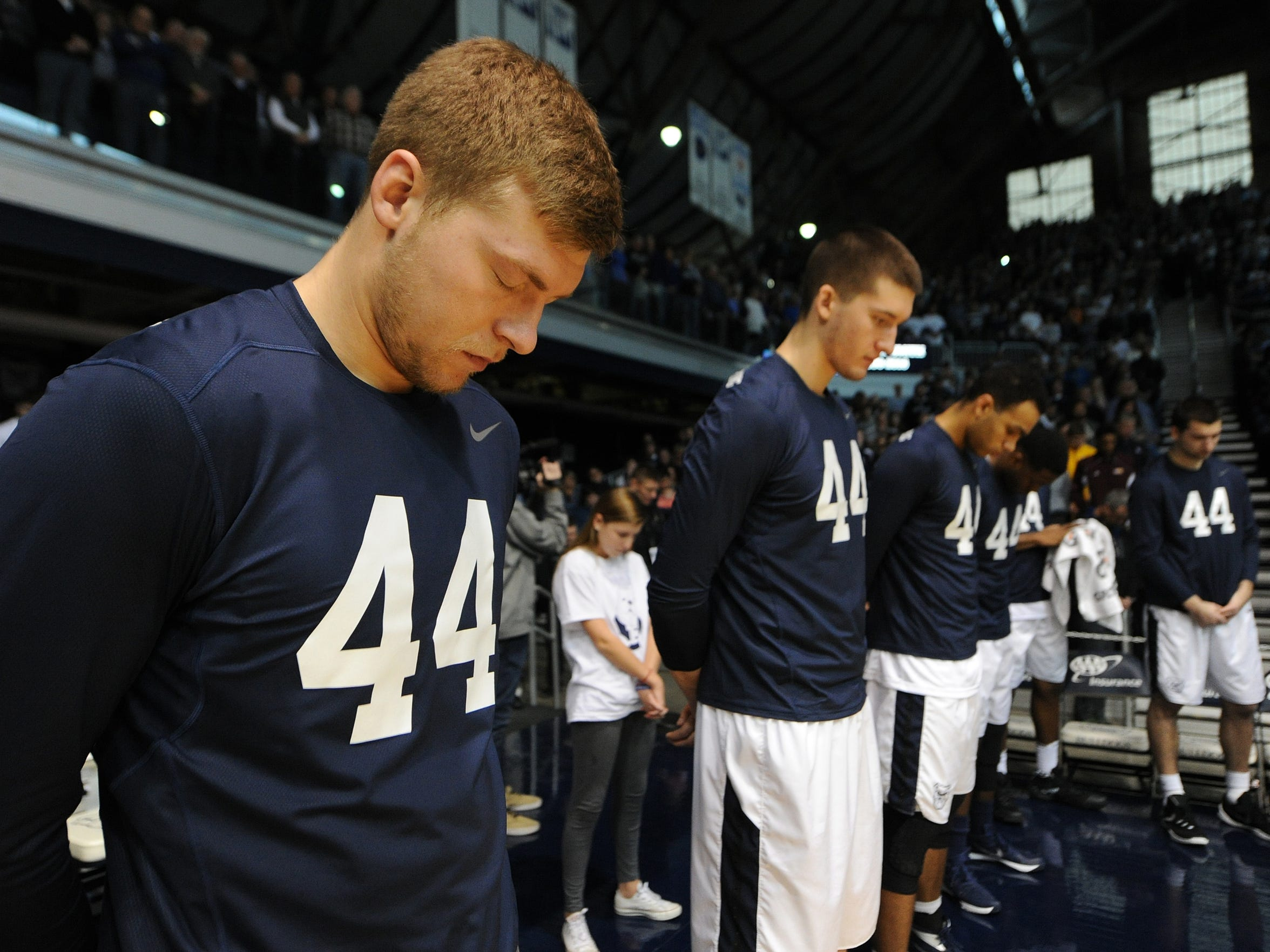 Butler players stand as they remember former player