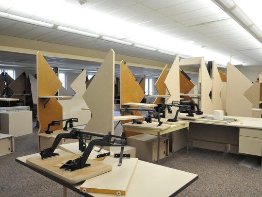 Desks left behind by Consolidated Paper wait to be