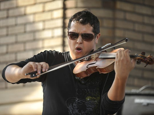 Patrick Contreras performs during Visalia's All Music