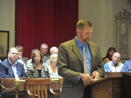 A crowd looks on as Crawford County Assistant Prosecutor