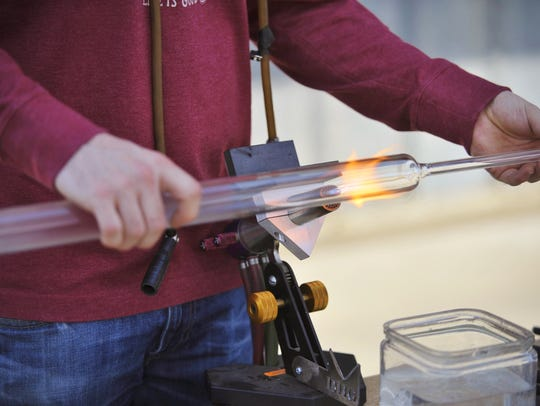 Mitchell Van Loon held a glass blowing demonstration