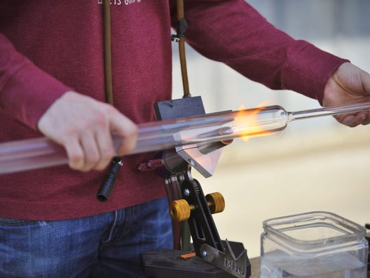 Mitchell Van Loon held a glass blowing demonstration during the 8th annual Taste the Arts festival in downtown Visalia.