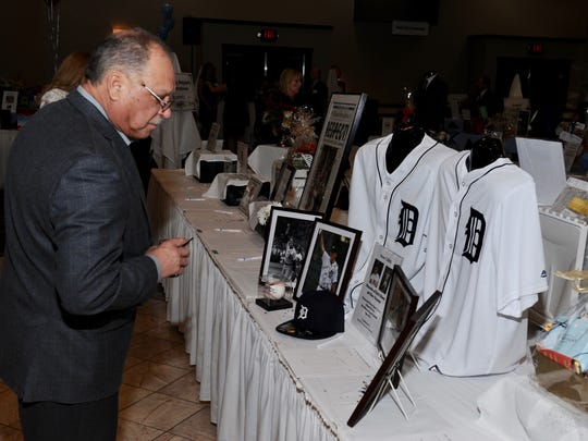 Garry Wally of Fitness Things browses the Tiger memorabilia.