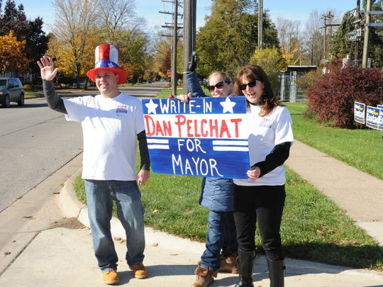 Dan Pelchat gets a little help looking for votes during Tuesday's general election.