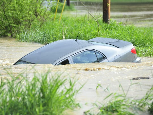 The driver of a car submerged in a river that crosses Home Road escaped safely Tuesday afternoon.
