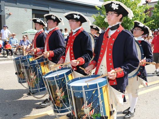 The Plymouth Fife & Drum Corps entertain the crowds in Northville.