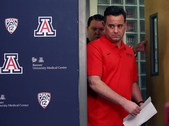 Arizona NCAA college basketball coach Sean Miller arrives for a press conference in Tucson, Ariz., Thursday, March 1, 2018.  Miller vehemently shot down a report claiming he discussed a six-figure payment to a top recruit and said he looks forward to continuing to coach the team. ESPN reported last Friday, using anonymous sources, that the FBI had Miller on a wiretap discussing a $100,000 payment to Wildcats freshman Deandre Ayton to attend the school.  (Mike Christy/Arizona Daily Star via AP)