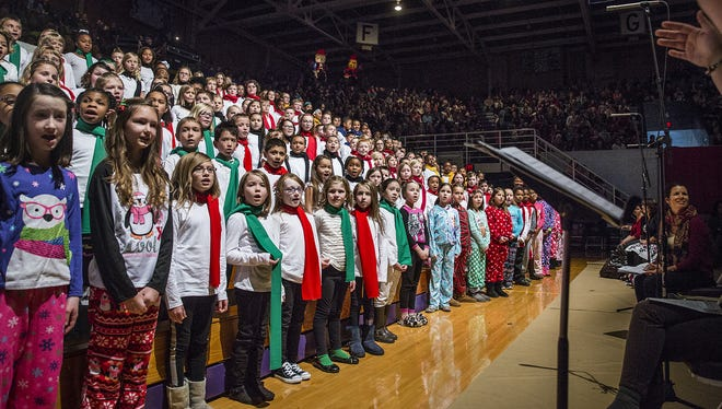 Students sing during the 2015 Community Christmas Sing at the Muncie Fieldhouse.