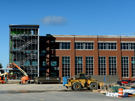Construction continues on the expansion of the  MSUFCU heaquarters Friday, Nov. 4, 2016 in East Lansing.