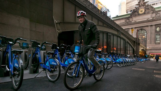 A Citi Bike cyclist picks up his ride near Grand Central Terminal in New York earlier this year.