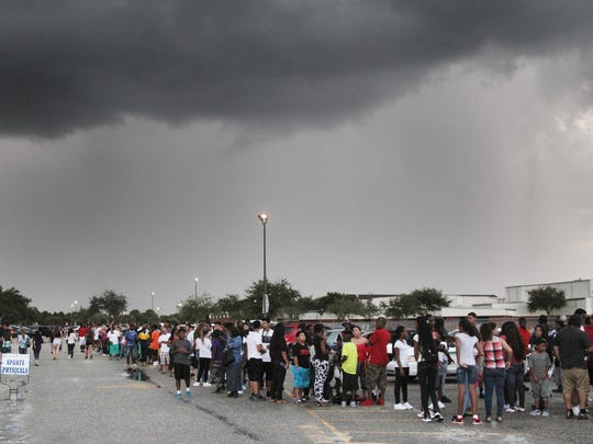 Fans wait to enter the stadium at Lehigh Senior High for a 2015 game against Dunbar. The weather never cleared so the game was postponed indefinitely.