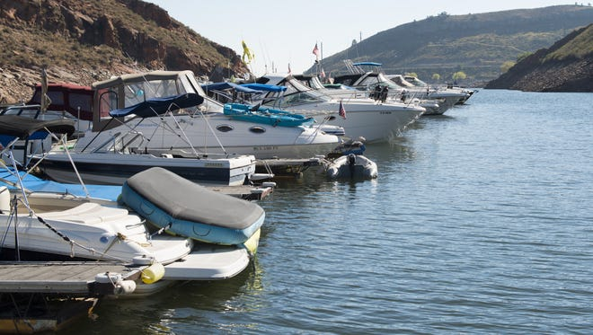 Boats dock at Inlet Bay Marina on Horsetooth Reservoir Saturday, September 26, 2015. Some owners live on the boats full-time during the summer months.