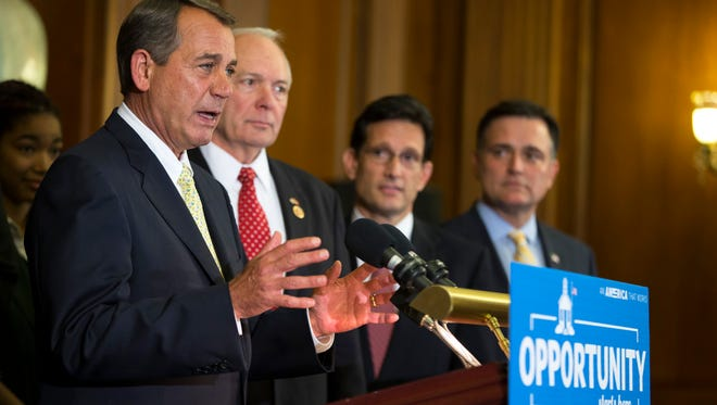 Speaker of the House Rep. John Boehner, R-Ohio, speaks during a news conference supporting charter schools on Capitol Hill, on Wednesday, May 7, 2014, in Washington, as from left, Rep. John Kline, R-Minn., Rep. Eric Cantor, R-Va., and Rep. Luke Messer, R-Ind., listen. (AP Photo/ Evan Vucci)