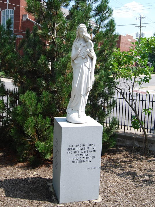 Statue Dedicated to the birth mothers and adoptive parents of Catholic Chari.jpg