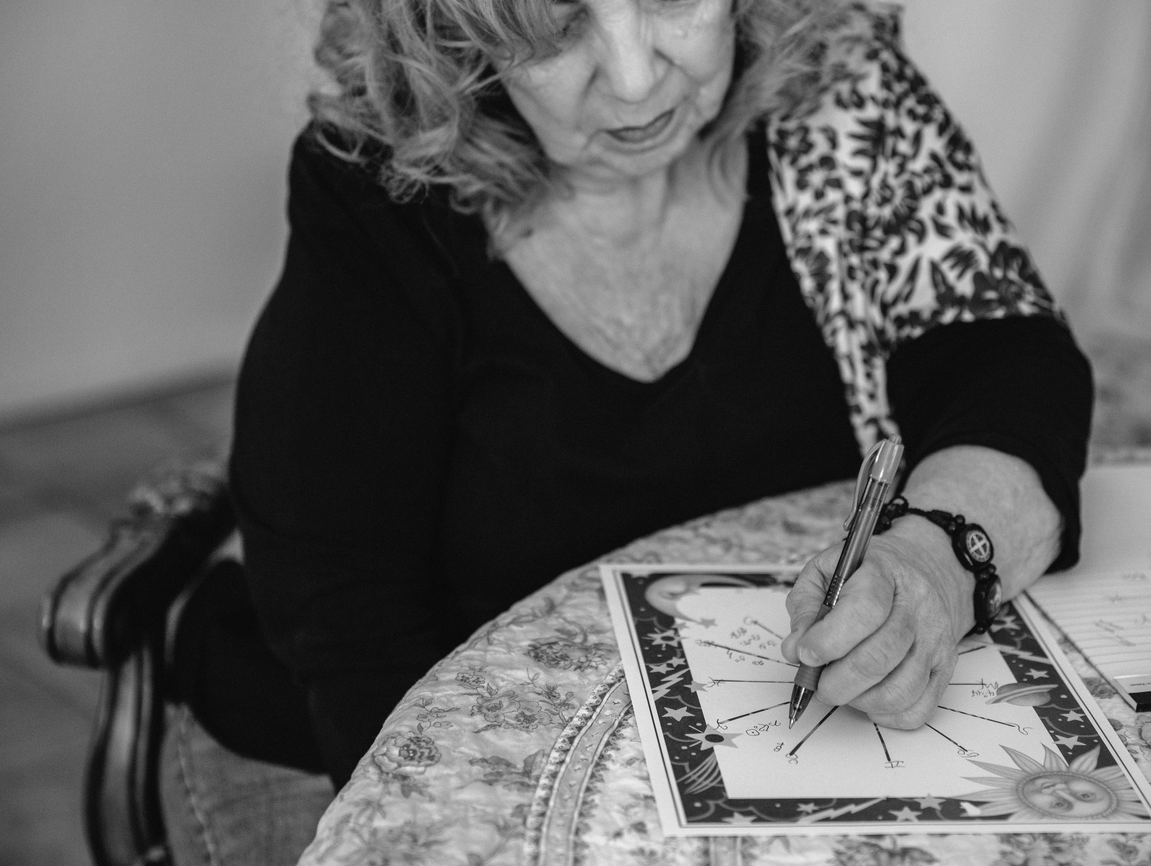 Astrologer Dana Haynes conducts a reading in her home