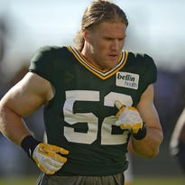 Green Bay Packers linebacker Clay Matthews (52) and his teammates stretch during training camp practice at Ray Nitschke Field on Saturday, Aug. 1, 2015.