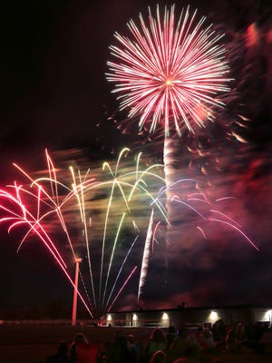 Fireworks explode near the Ontario football field for the town's annual 4th of July Celebration on Saturday.