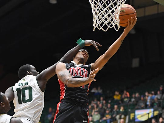 UNLV Rebels forward Troy Baxter Jr. (31) is fouled by Colorado State Rams forward Che Bob (10) in the second half at Moby Arena. The Rams defeated the Rebels 91-77 in Fort Collins, Colo., on  Dec 28, 2016.