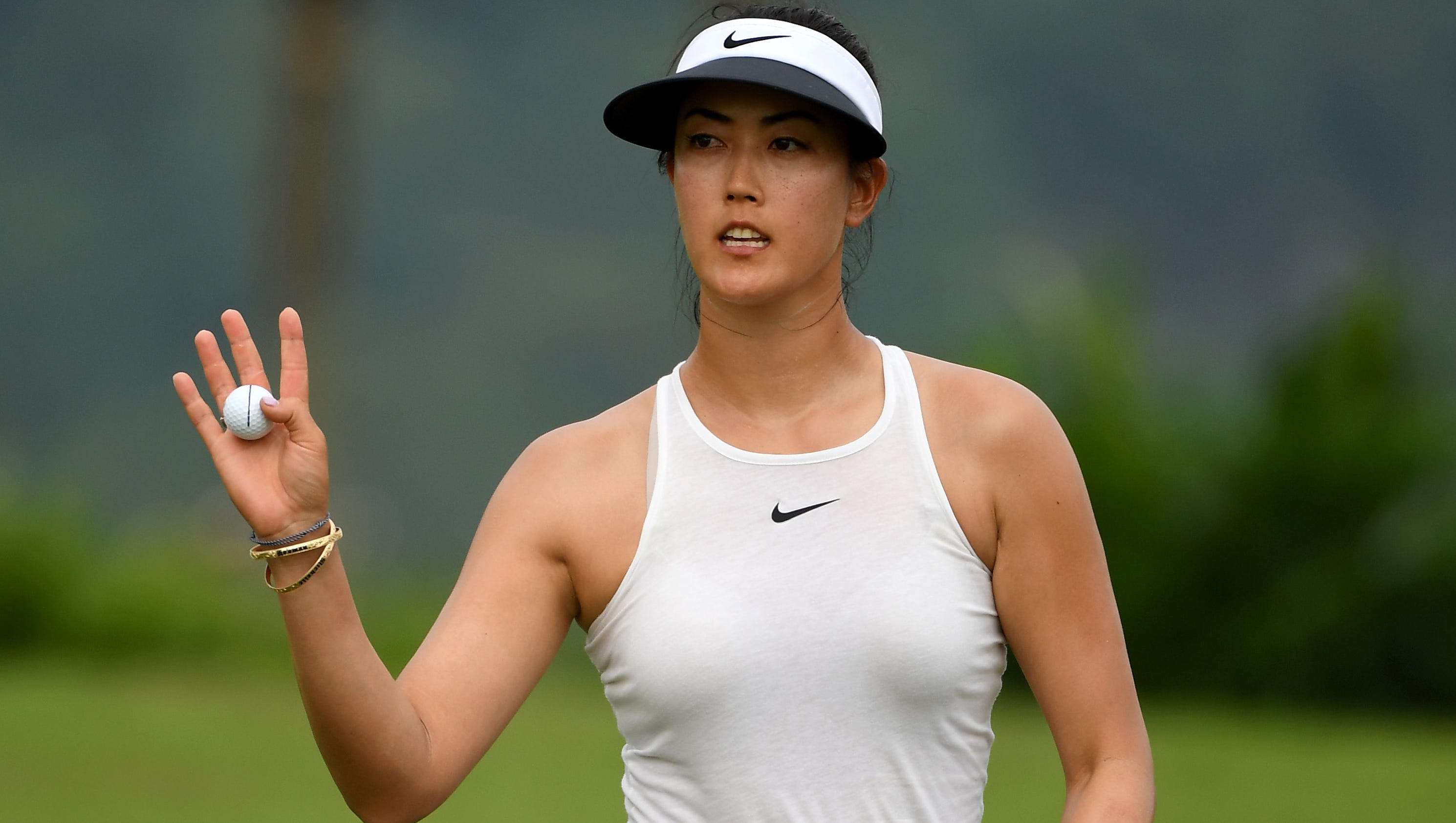 Michelle Wie shoots 67, takes two-shot lead in Singapore