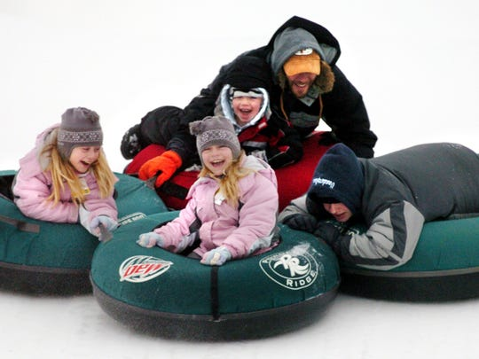 Powder Ridge near Kimball offers a snow tubing run, and sometimes is is open after dark as well.