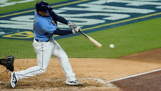 Rays catcher Mike Zunino hits an RBI single to score Rays' Willy Adames during the fifth inning of Game 1 of the American League Championship Series.