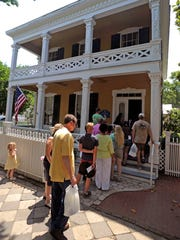 Visitors tour the Dorr House during a previous Historic